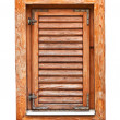 Italian style wooden window with closed shutter blinds — Stock Photo #41899489