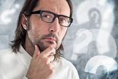 Businessman thinking and questioning — Stock Photo