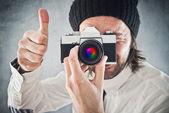 Businessman taking photo with vintage film camera — Stock Photo