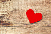Paper heart on wood background — Stockfoto