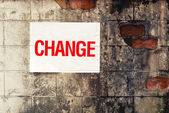 Change Poster on grunge wall — Stock Photo