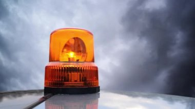 Flashing beacon. Orange flashing and rotating light on top of a support and services vehicle. — Wideo stockowe