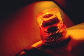 Turuncu yanıp sönen ve dönen ışık — Stok fotoğraf