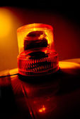 Orange flashing and rotating light — Stock Photo