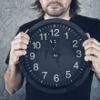 Man holding big black clock — Stock Photo #43131413