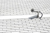 Security camera on the wall. Private property protection. — Stock Photo