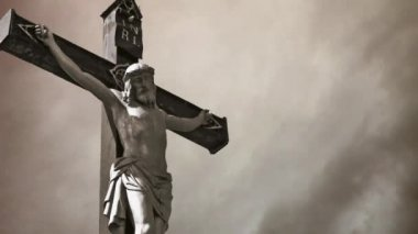 Crucifixion. Christian cross with Jesus Christ statue over stormy clouds time lapse. — Stock Video