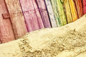 Vintage wooden fence in rainbow colors — Stock Photo