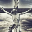 Crucifixion. Christian cross with Jesus Christ statue over storm — Stock Photo #44201553