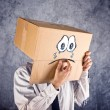 Businessman with cardboard box on his head and sad face expressi — Stock Photo #44334809