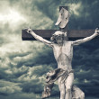 Crucifixion. Christian cross with Jesus Christ statue over storm — Stock Photo #44334895