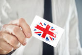 British Businessman holding business card with Great Britain Fla — Stock Photo