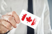 Canadian Businessman holding business card with Canada Flag — Stock Photo