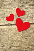Paper hearts on wood background — Stock fotografie