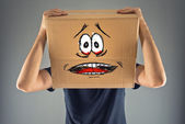 Man with cardboard box on his head and terrified look skethed — Stock Photo