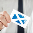 Scotish Businessman holding business card with Scotland Flag — Stock Photo #44526695