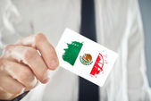Mexican Businessman holding business card with Mexico Flag — Stock Photo