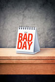 It's a bad day printed on desk calendar at office table — Stock Photo