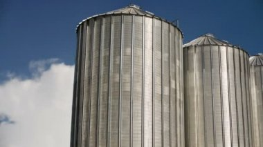 Grain Silos under Clouds time lapse footage. Agricultural background. — Stock Video