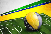 Soccer ball with Bosnia and Herzegovina flag on pitch — Stock Photo