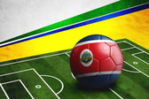 Soccer ball with Costa Rica flag on pitch — Stok fotoğraf