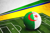 Soccer ball with Algeria flag on pitch — ストック写真