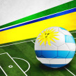 Soccer ball with Uruguay flag on pitch — Stock Photo