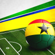 Постер, плакат: Soccer ball with Ghana flag on pitch