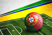 Soccer ball with Portugal flag on pitch — Foto de Stock