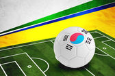 Soccer ball with South Korea flag on pitch — ストック写真