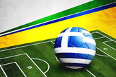 Soccer ball with Greece flag on pitch — Foto de Stock
