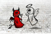 Angel and devil fighting - doodle drawing on white brick wall — Stock Photo