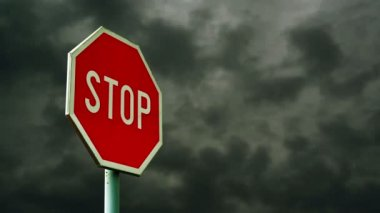 Red stop sign on the street. Roadside traffic sign for stopping with clouds time lapse footage in background. 1920x1080, 1080p, hd footage — Stock Video