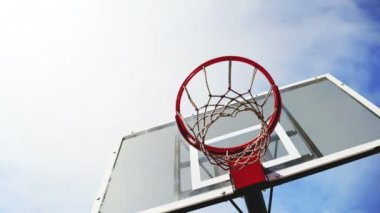 Basketball hoop with cage with clouds time lapse footage in background. 1920x1080, 1080p, hd footage. — Stock Video