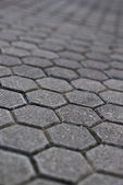 Cobblestone pavement with shallow depth of field — Stock Photo