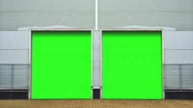 Industrial Unit with roller shutter doors. Warehouse storage doors with green screen mate background are closing. 1920x1080, 1080p, hd, high definition footage. — Stockvideo