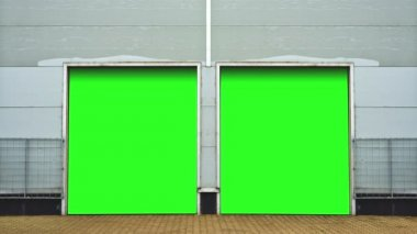Industrial Unit with roller shutter doors. Warehouse storage doors with green screen mate background are closing. 1920x1080, 1080p, hd, high definition footage. — Vídeo de Stock
