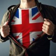 Man stretching jacket to reveal shirt with great Britain flag — Stock Photo