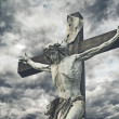 Crucifixion. Christian cross with Jesus Christ statue over storm — Stock Photo #46169459