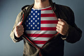 Man stretching jacket to reveal shirt with USA flag — Stock Photo