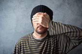 Man covering eyes — Stock Photo