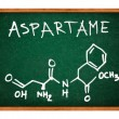 Aspartame chemical formula on school chalkboard — Stock Photo