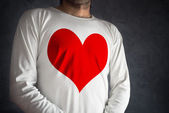 Man in white shirt with big red heart printed — Stock Photo