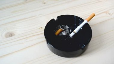 Cigarette burning in black ashtray on the table. 1920x1080, 1080p, full hd footage. — Stock Video