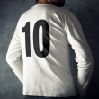 Man wearing sport shirt with number ten — Stock Photo #46661605