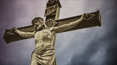 Crucifixion. Christian cross with crucified Jesus Christ statue over dark clouds time lapse. 1920x1080 full hd format. — Stock Video