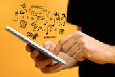 Hands with tablet computer and various doodle icons  — Stock Photo