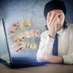 Online money funds, surprised businessman receiving cash over in — Stock Photo #47002947