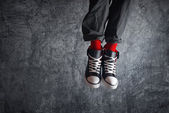 Excited man in sneakers jumping — Stockfoto
