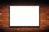 Blank poster on old brick wall — Stock Photo
